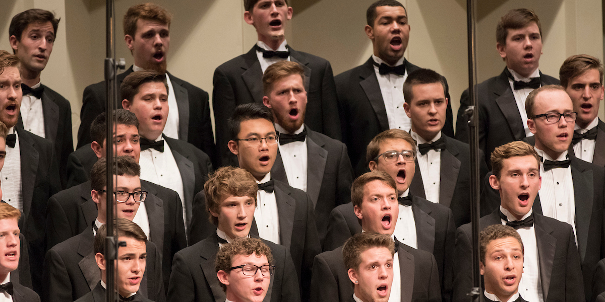 Closeup of a section of singers in the mens glee club concert