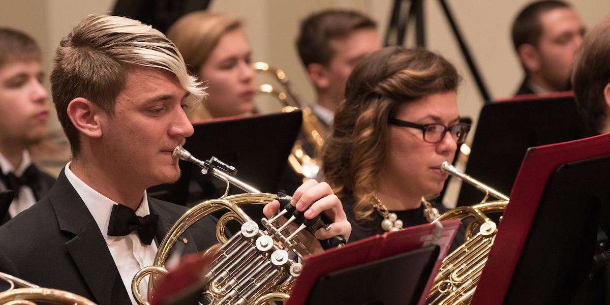 Closeup of horns playing in symphony band concert at Hall Auditorium