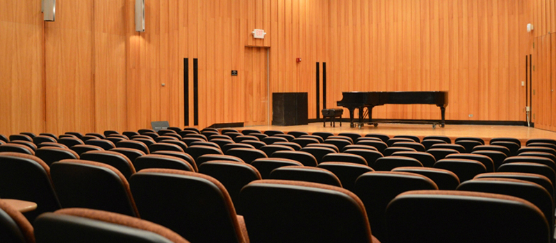 Souers Recital Hall showing seats and grand piano onstage
