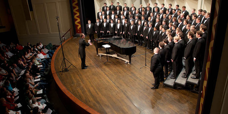 Glee Club performing onstage at Hall Auditorium