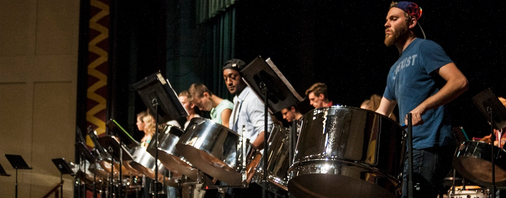 Front row of performers at Steel Band concert, Hall Auditorium
