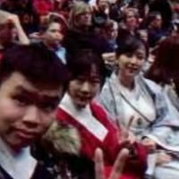 Students in the audience look at the camera