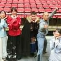 Students pose with Chinese Warriors performer