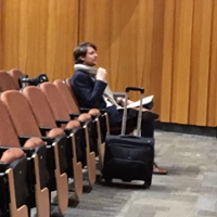David Fray takes notes from the audience as a student performs onstage at Souers Recital Hall