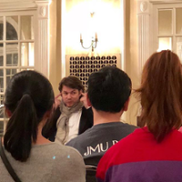 David Fray illustrates a concept by touching his ears as he chats with piano students after concert