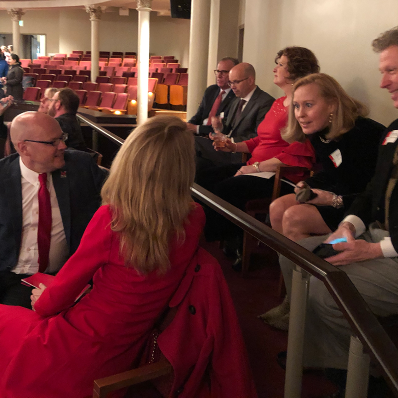 The Crawfords chat with seatmates during intermission