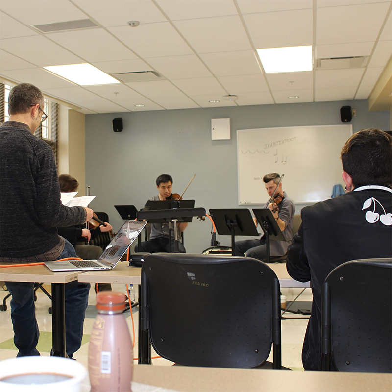 ETHEL working with Miami students in a music classroom