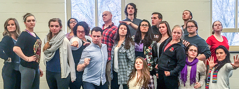 People strike humorous poses in Master class group picture featuring Intergalactic Nemesis as guest lecturers