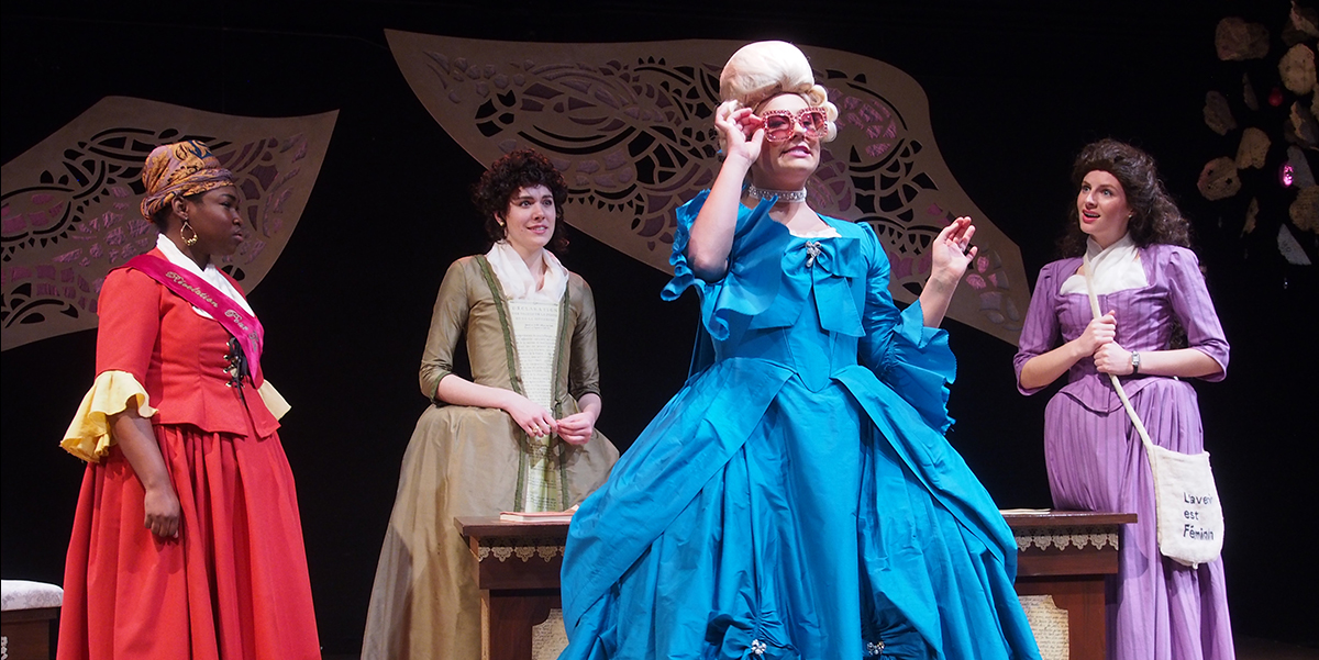 A group of student actors perform in the play The Revolutionists