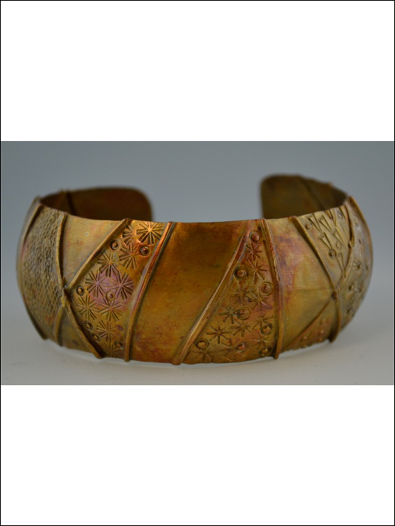 Metal bangle bracelet by Ginger Seiple