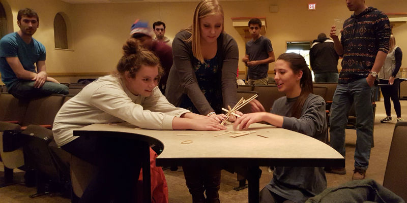 3 students launch a self-build catapult during engineers week