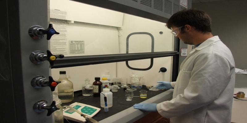 Male student working with chemicals