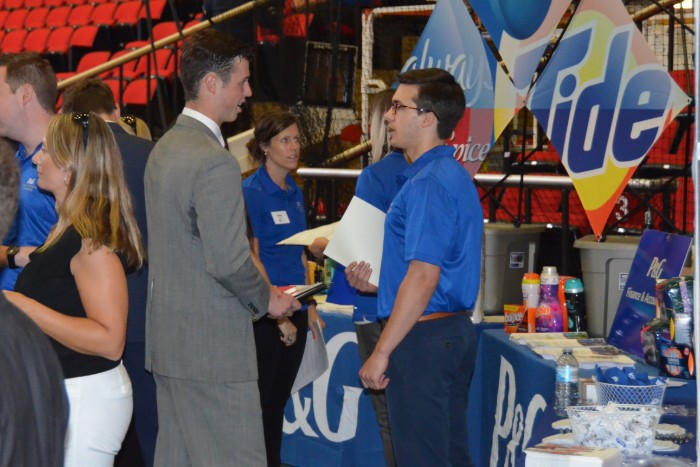 A student speaking with a recruiter at Career Fair