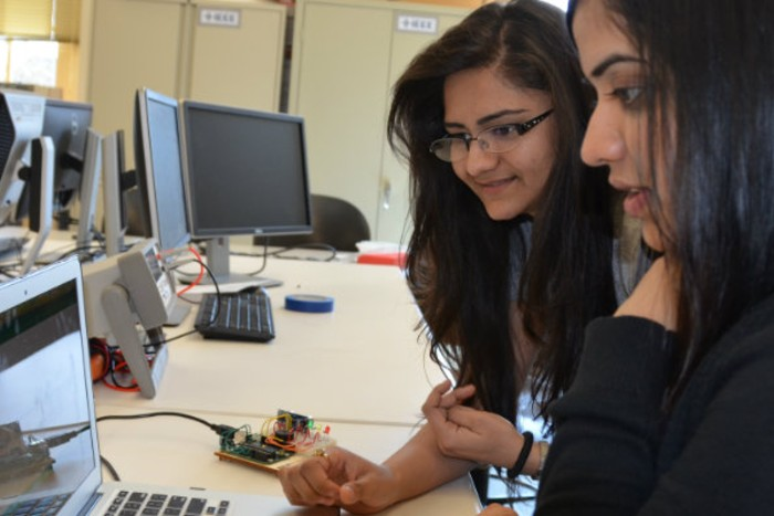 Dr. Rajasehkar and a female student looking at a computer