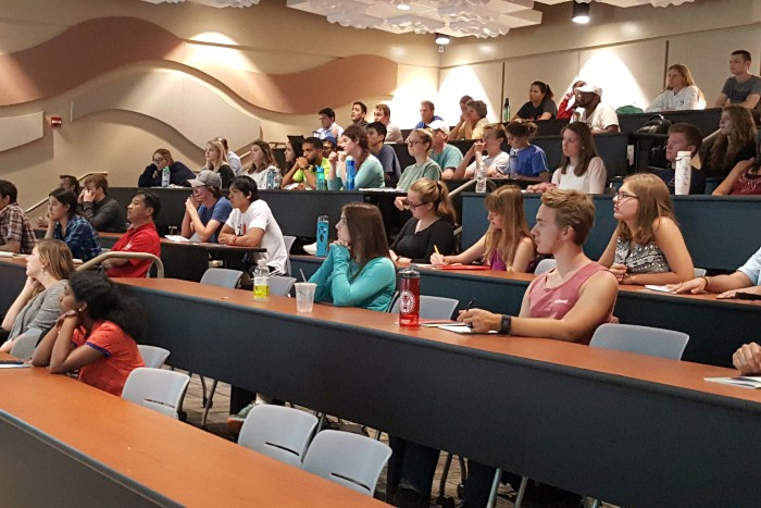 Many students sitting in a lecture hall