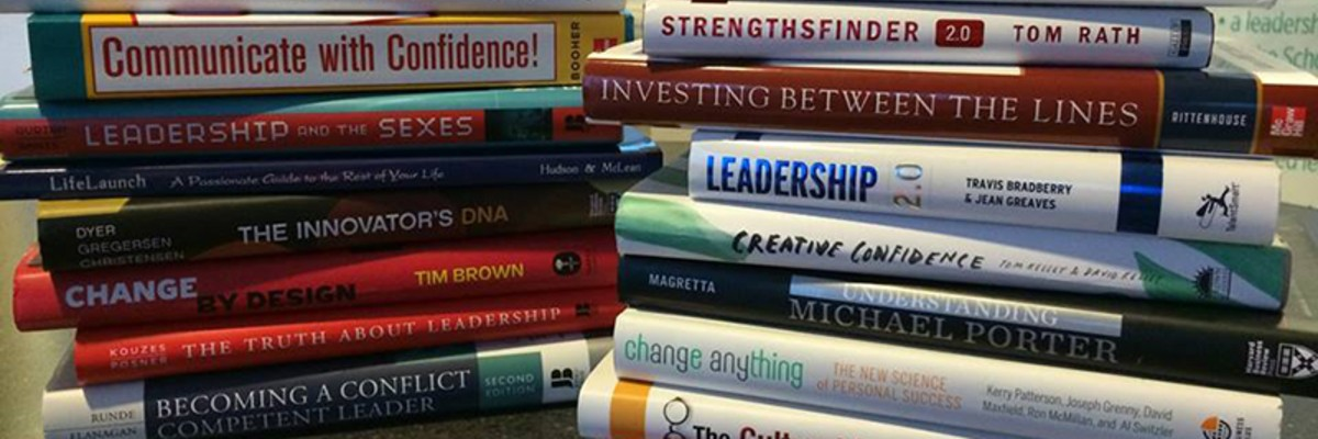 Two stacks of books that the leadership institute students read throughout their 3 years with the program