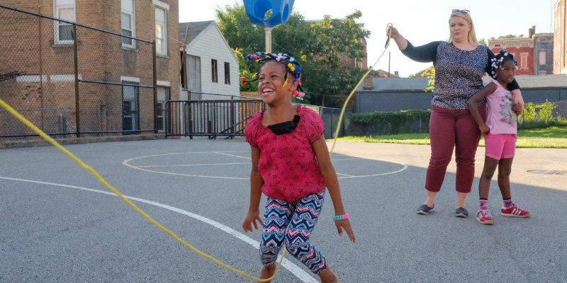 african-american girl jump ropes