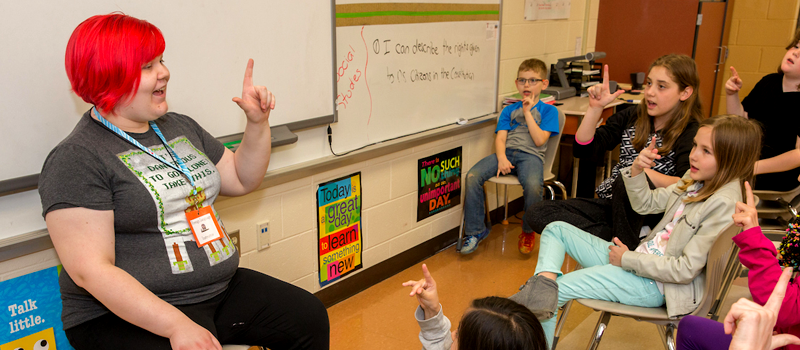 student teaching foreign language to group of children
