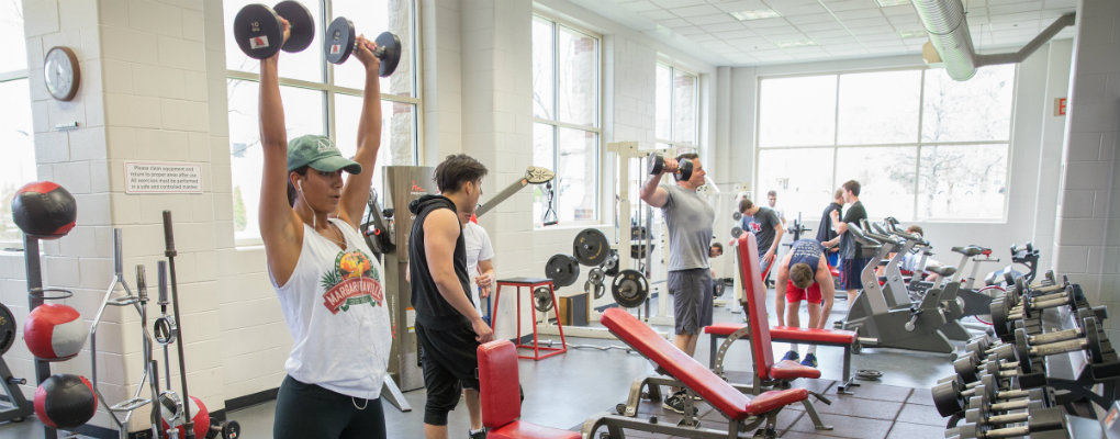 students lifting weights