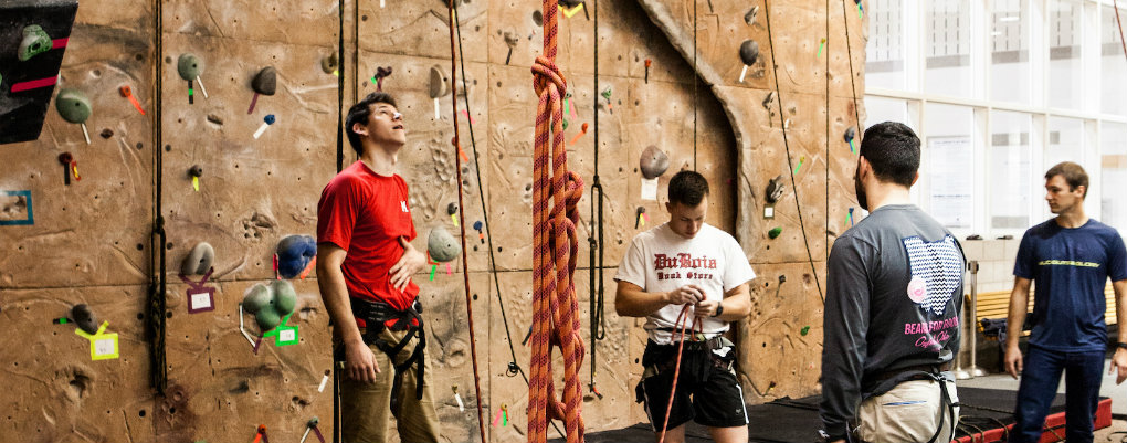 students rock climbing