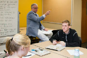 Teacher Education Professor Thomas Misco engages his students in a discussion