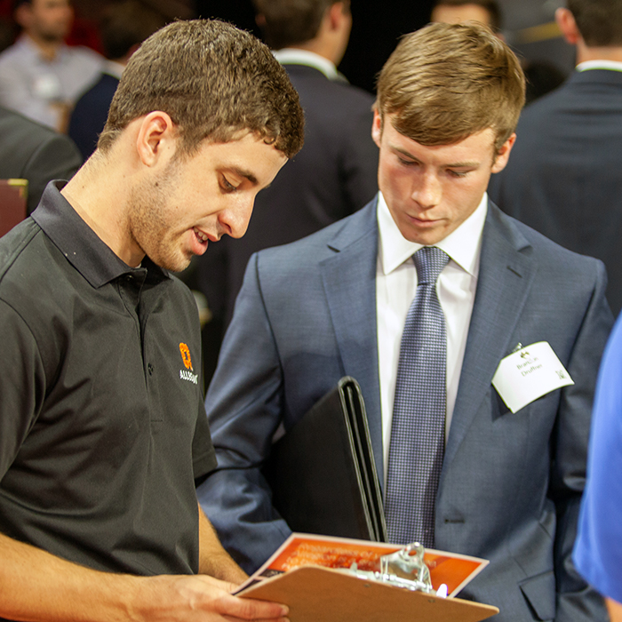 Student pitching an employer at Career Fair