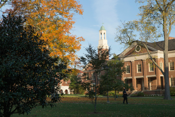 student walking behind Roudebush hall in the fall