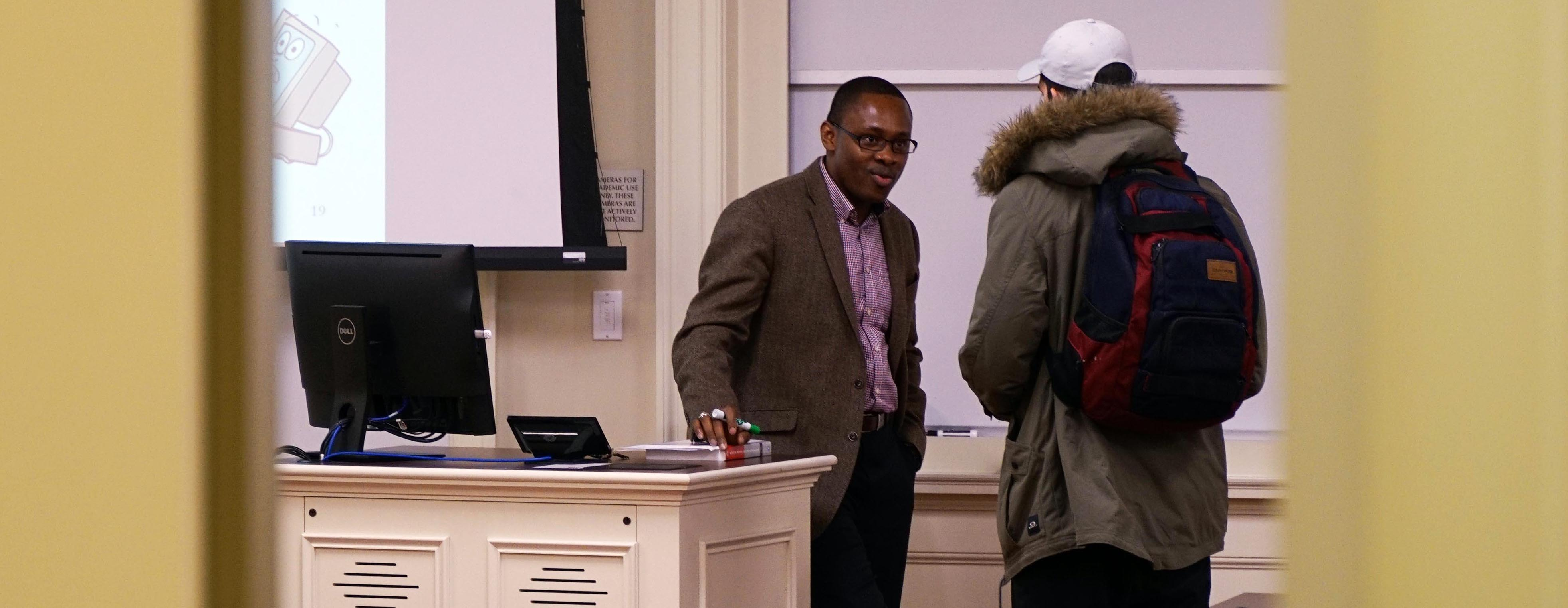 Dr. Joseph Nwankpa talks with a student after class