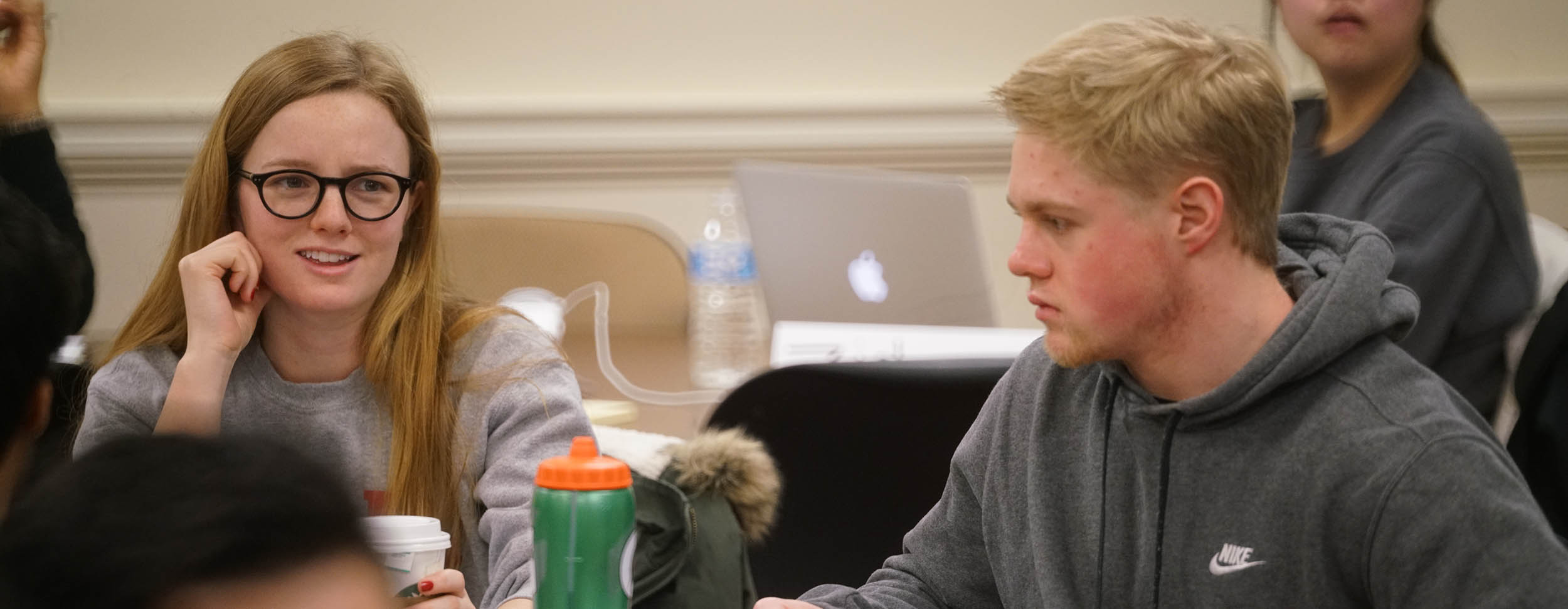 Two students sit at a table in Brenda Homan's accounting class