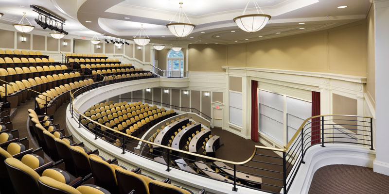 Taylor Auditorium from above. View of a half-circle auditorium with yellow chairs.