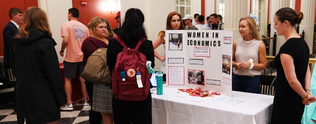 Students staff a Women in Economics table at Meet the B-Orgs