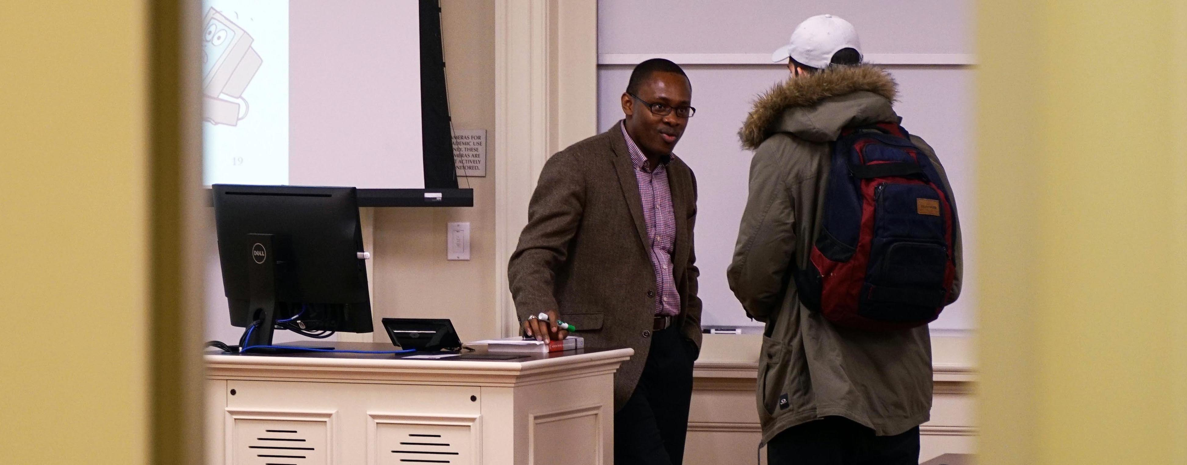 Joseph Nwankpa talks with a student before class