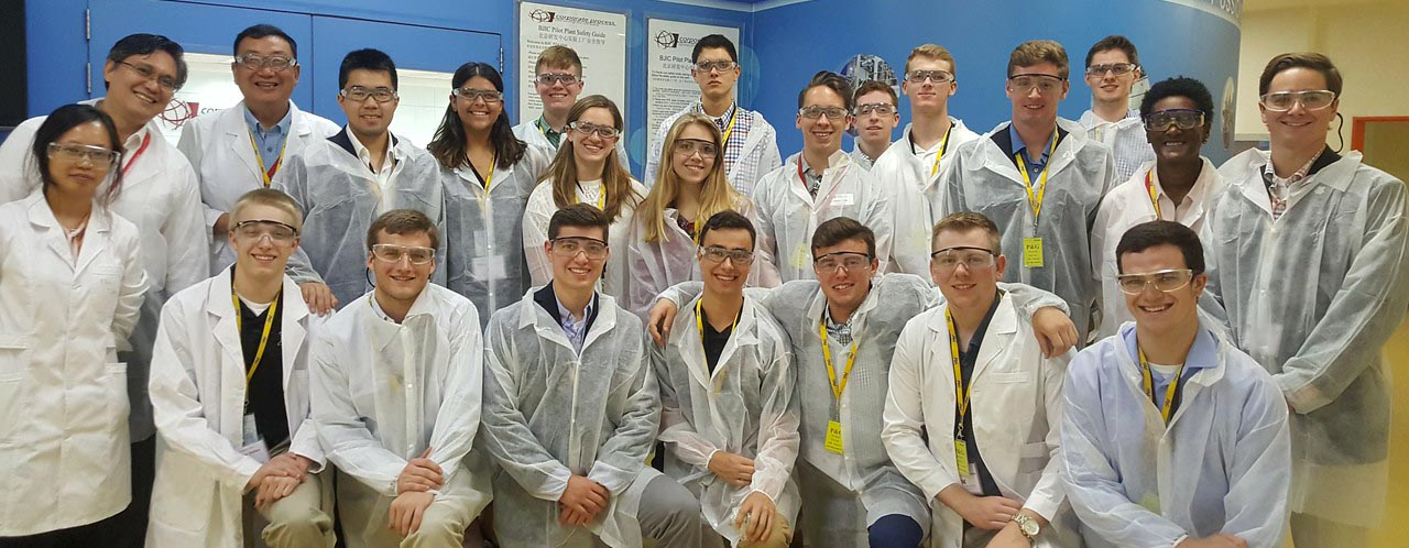 Students at lab in Asia, wearing protective clothing
