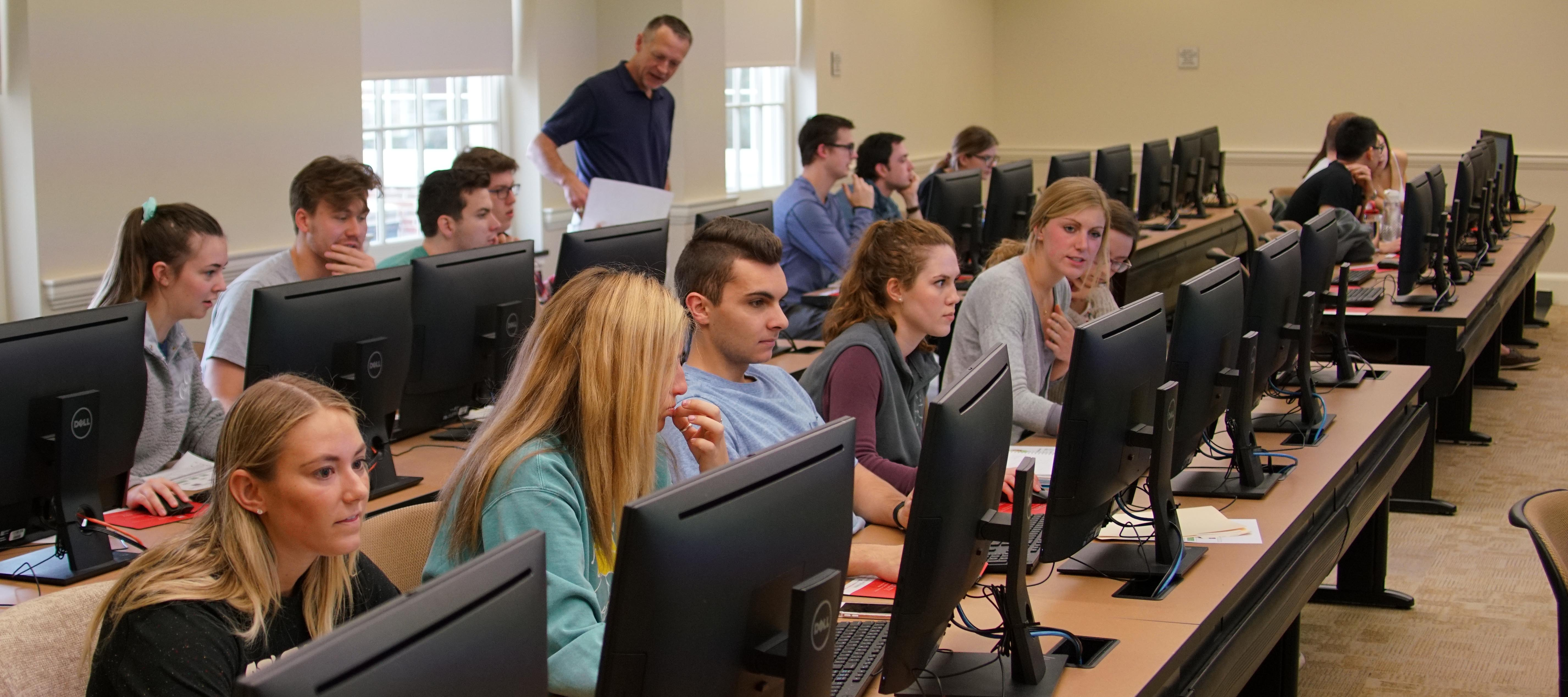 Students behind computers in ISA class