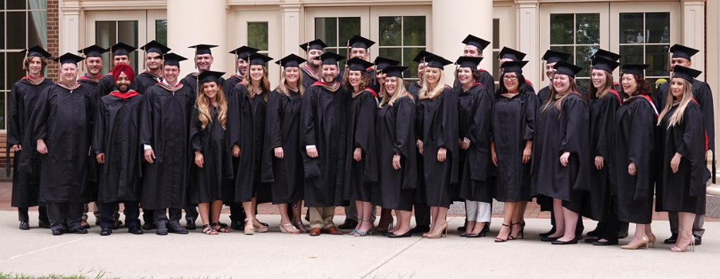 Graduating class of MBAs poses for photos