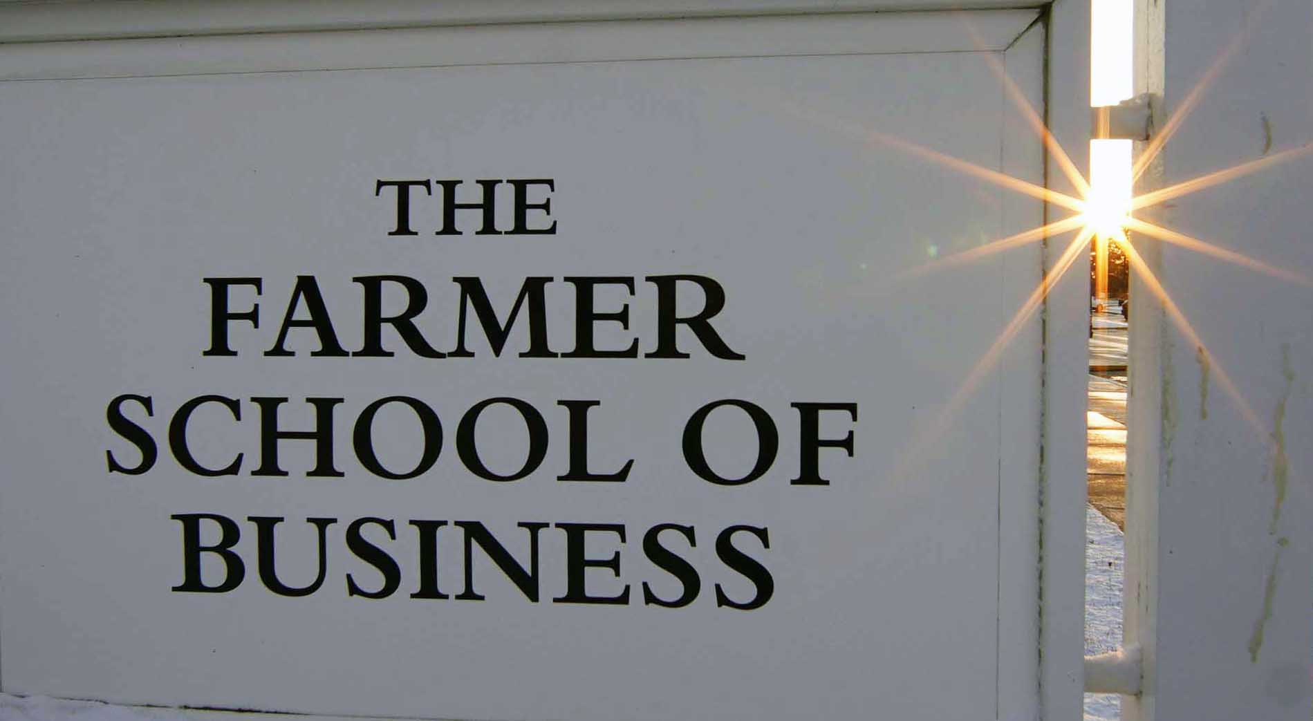 Farmer School sign with sunburst on right side