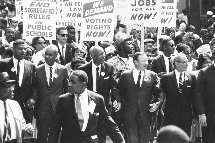 group of people marching with signs