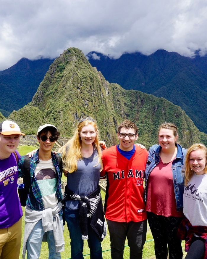 Miami students standing in front of Machu Picchu in Peru