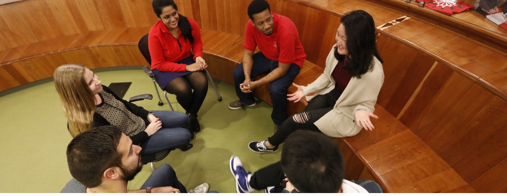 group discussion between Miami staff, faculty, and students; smiles; sitting in circle
