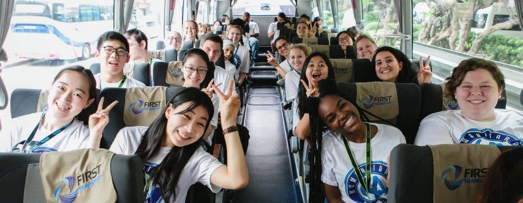 students on a bus at a past Humanitarian Leadership conference