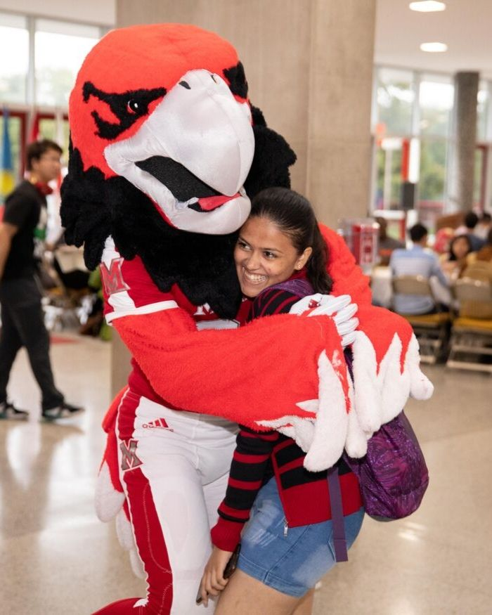 international student hugging Swoop
