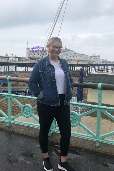 Halie Barger stands on Brighton Pier