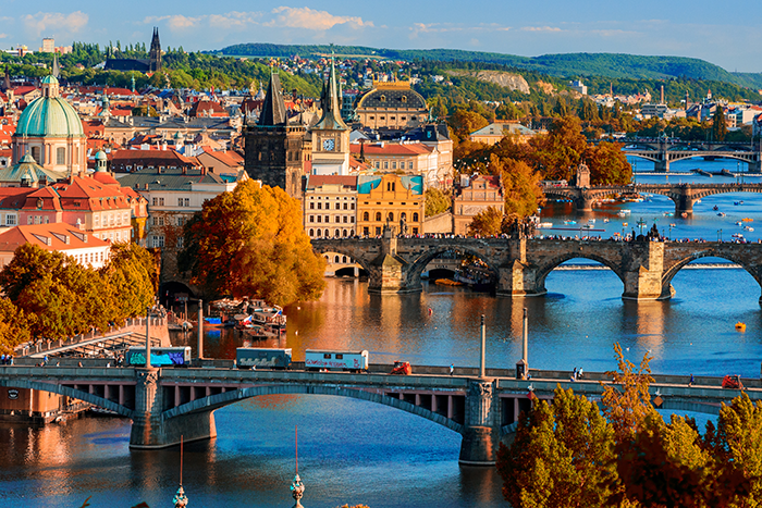 View of the Vltava River and Charle bridge with red foliage, Prague, Czech Republic