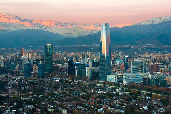 Panoramic view of Providencia and Las Condes districts with The Andes Mountain Range at sunset in Santiago