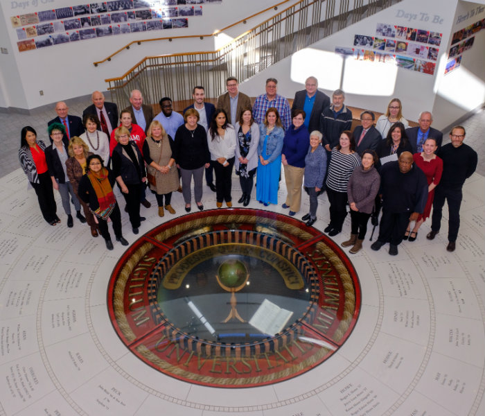 Group of alumni judges in front of the seal in Armstrong