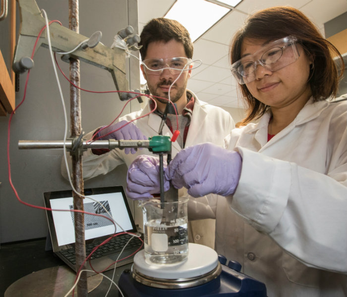 Two students working together in a lab