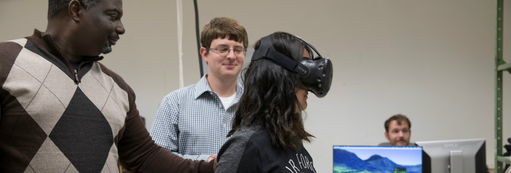 Student wearing a virtual reality simulator conducting an experiment