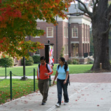 Two students walking on an autumn day