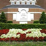 A block M made of flowers in front of Pearson Hall