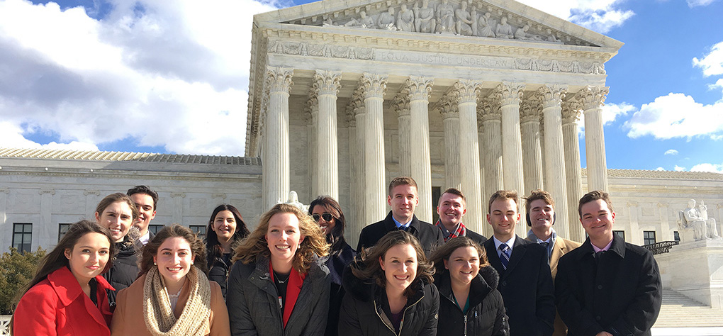 Inside Washington students in front of the Supreme Court building.